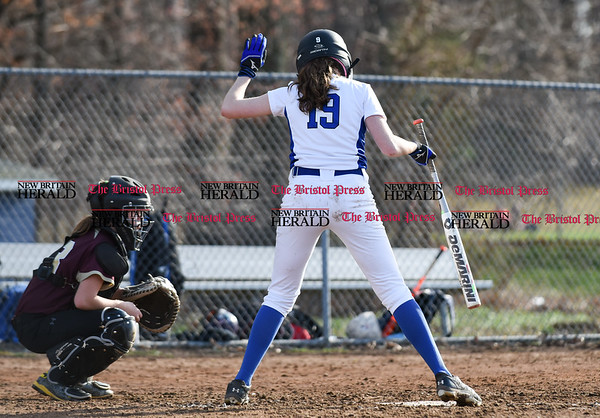 041217 Wesley Bunnell | Staff Southington High School softball defeated South Windsor 3-1 on Wednesday afternoon. Sarah Myrick (19) in her pre at bat ritual digs in as she twirls the bat several times.