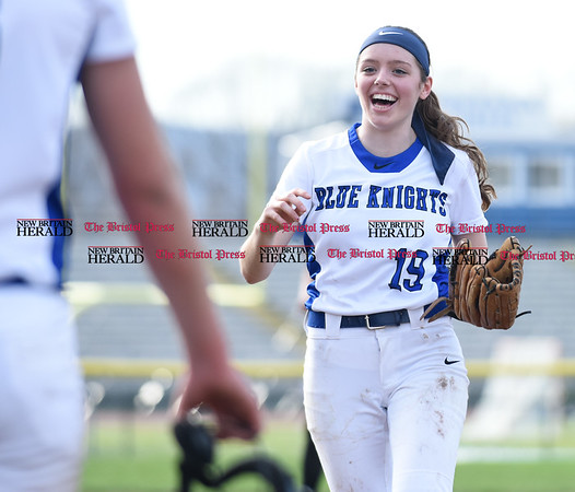 041217 Wesley Bunnell | Staff Southington High School softball defeated South Windsor 3-1 on Wednesday afternoon. Sarah Myrick (19) is all smiles as she leaves the field between half innings.
