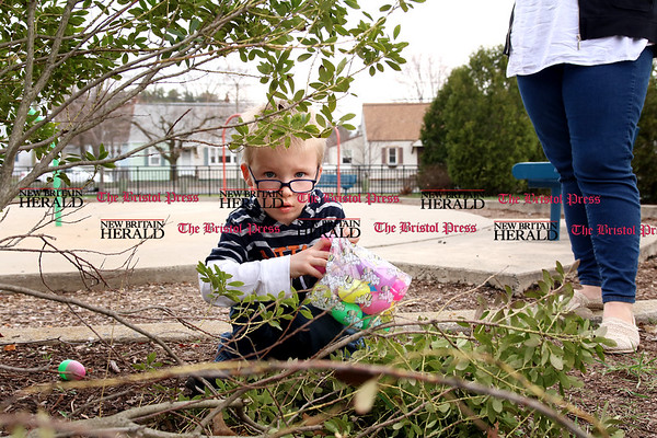 Licensed childcare providers gathered at Stocks Playground with the children in their care, including Robert Tardiff, for a visit from the Easter Bunny and an Easter egg hunt.