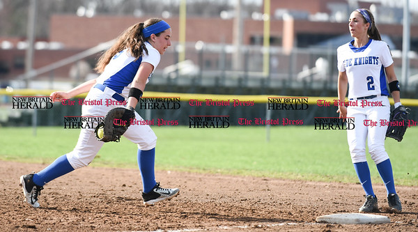 041217 Wesley Bunnell | Staff Southington High School softball defeated South Windsor 3-1 on Wednesday afternoon. Frankie Ferrante (5) loses the ball momentarily on a ball hit to first base but recovered for the out as Michelle Woodruff (2) backs up the play.