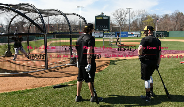 041117 Wesley Bunnell | Staff The New Britain Bees held their media day on Tuesday afternoon before holding open tryouts later in the evening. Coach Daisuke Yoshida throws batting practice to catcher Ivan Villaescusa as Kevin Putkonen and Cody Charnesky stand outside of the cage.