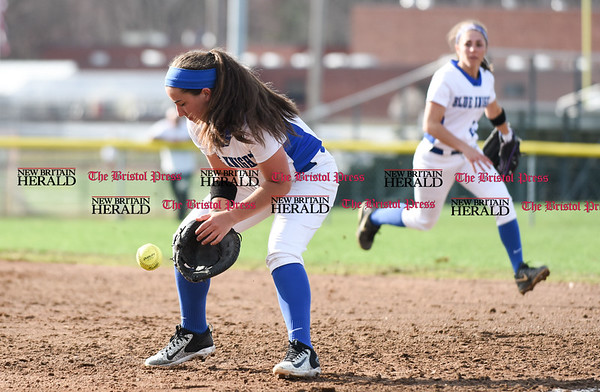041217 Wesley Bunnell | Staff Southington High School softball defeated South Windsor 3-1 on Wednesday afternoon. Frankie Ferrante (5) loses the ball momentarily on a ball hit to first base but recovered for the out.