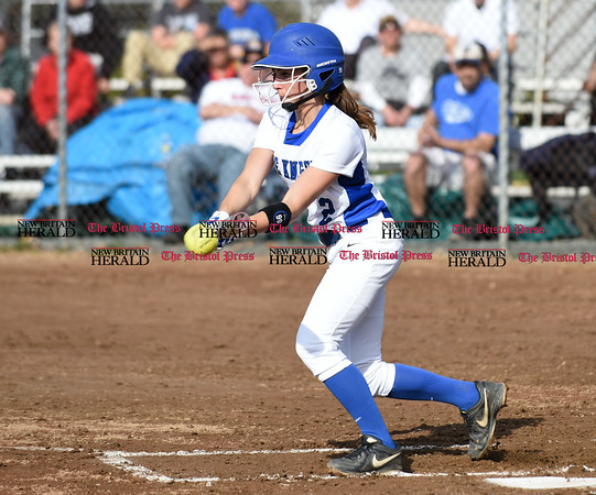 041217 Wesley Bunnell | Staff Southington High School softball defeated South Windsor 3-1 on Wednesday afternoon. Michelle Woodruff (2) with a bunt.