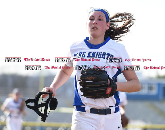 041217 Wesley Bunnell | Staff Southington High School softball defeated South Windsor 3-1 on Wednesday afternoon. Kara Zazzaro (18) jogs off the field at the end of an inning.
