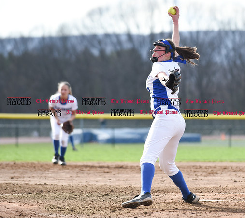 041217 Wesley Bunnell | Staff Southington High School softball defeated South Windsor 3-1 on Wednesday afternoon. Kara Zazzaro (18) in mid delivery.