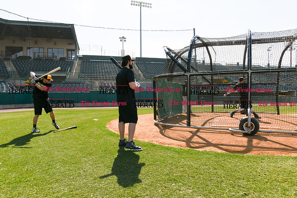 041117 Wesley Bunnell | Staff The New Britain Bees held their media day on Tuesday afternoon before holding open tryouts later in the evening. From left are Michael Baca, Kevin Putkonen and Cody Charneski in the batting cage.