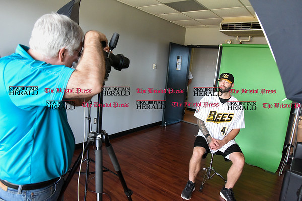 041117 Wesley Bunnell | Staff The New Britain Bees held their media day on Tuesday afternoon before holding open tryouts later in the evening. Jeff DiCosimo of Premier Portraits Studio photographs Bees player Joe Beimel (45) for his official team photo.