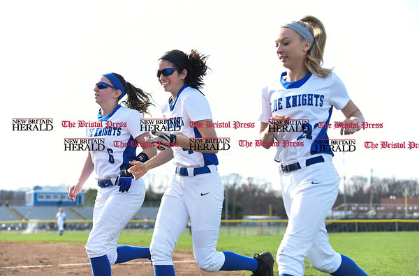 041217 Wesley Bunnell | Staff Southington High School softball defeated South Windsor 3-1 on Wednesday afternoon. Keeping loose between innings are Kelly Graff (6), Mikaela June (4) and Mackenzie Beaupre (21).