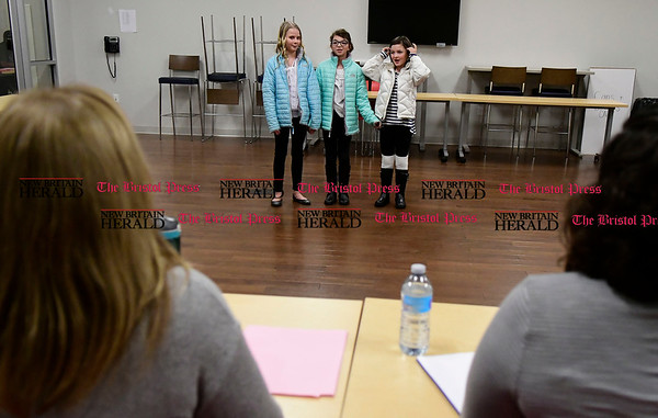 "1/19/2017 Mike Orazzi | Staff Elena Thomasson, Julia Riedel and Elle Thomasson sing while auditioning for the 76th annual Older Members (OM) Show, ""There's No Place Like Home.&quote; held at the Bristol Boys & Girls Club Thursday evening. Show dates this year are April 21 and 22."