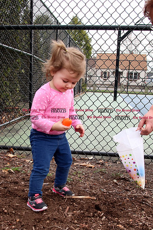 Licensed childcare providers gathered at Stocks Playground with the children in their care, including Sadie Montiniere, for a visit from the Easter Bunny and an Easter egg hunt.