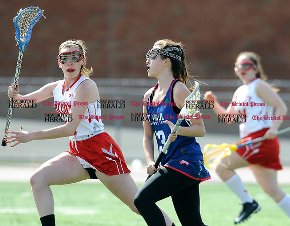 4/12/2017 Mike Orazzi | Staff Wolcott's Madison Berthold (3) and St. Paul's Olivia Stump (13) in Wolcott Wednesday.