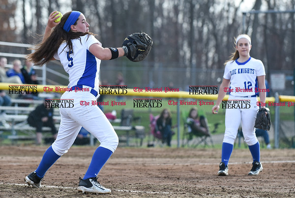 041217 Wesley Bunnell | Staff Southington High School softball defeated South Windsor 3-1 on Wednesday afternoon. Frankie Ferrante (5) fields a bunt and throws to first.