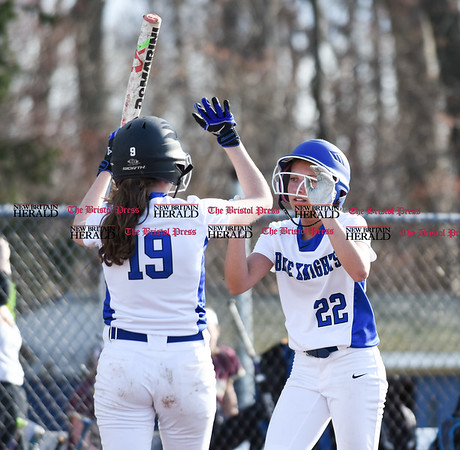 041217 Wesley Bunnell | Staff Southington High School softball defeated South Windsor 3-1 on Wednesday afternoon. Chrissy Marotto (22) is congratulated by Sarah Myrick (19) after scoring a run on a throwing error by South Windsor.
