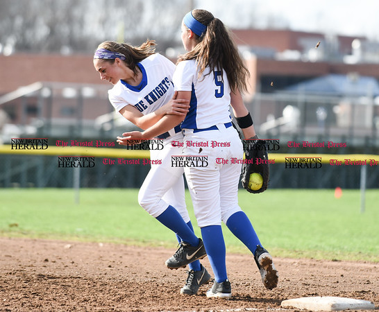 041217 Wesley Bunnell | Staff Southington High School softball defeated South Windsor 3-1 on Wednesday afternoon. Michelle Woodruff (2), left and Frankie Ferrante (5) after an out at first.
