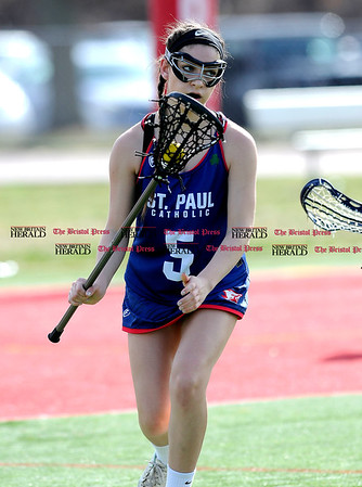 4/12/2017 Mike Orazzi | Staff St. Paul's Carolyn Del Debbio (5) during Wednesday's lacrosse at Wolcott High School.