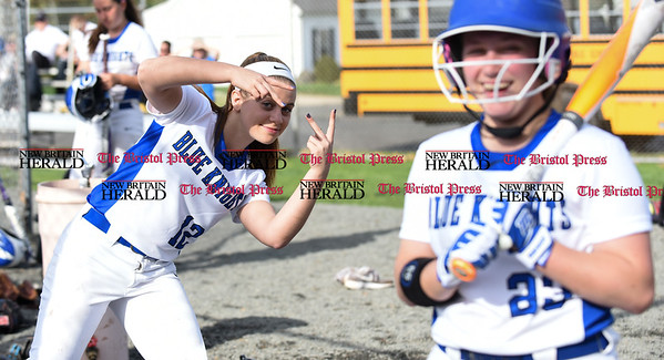 041217 Wesley Bunnell | Staff Southington High School softball defeated South Windsor 3-1 on Wednesday afternoon. Tori Aldieri (12) photobombs her teammate Amanda Delorme (23).