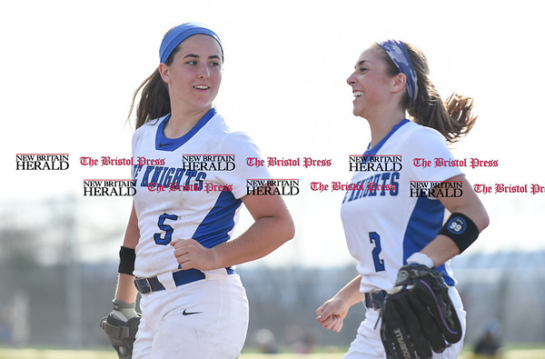 041217 Wesley Bunnell | Staff Southington High School softball defeated South Windsor 3-1 on Wednesday afternoon. Jogging off the field at the end of a half inning is Frankie Ferrante (5) and Michelle Woodruff (2).