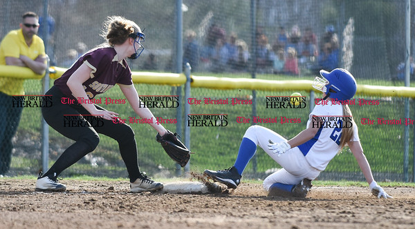 041217 Wesley Bunnell | Staff Southington High School softball defeated South Windsor 3-1 on Wednesday afternoon. Chrissy Marotto (22) slides into third base. The ball would make it past the fielder allowing Marotto to score.