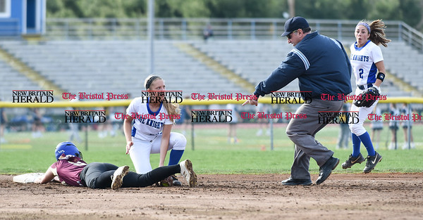 041217 Wesley Bunnell | Staff Southington High School softball defeated South Windsor 3-1 on Wednesday afternoon. Chrissy Marotto (22) tags the South Windsor runner for an out to end the inning on an attempted steal as Michelle Woodruff (2) reacts to the call.