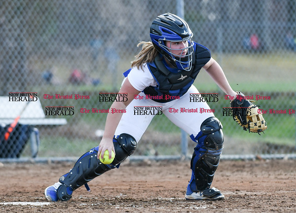 041217 Wesley Bunnell | Staff Southington High School softball defeated South Windsor 3-1 on Wednesday afternoon. Maighread Scafariello (9) fields the bunt attempt.
