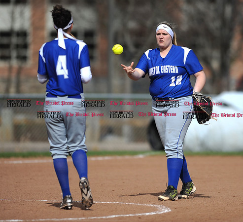 4/13/2017 Mike Orazzi | Staff Bristol Eastern's Lauren Aparo (4) and Mikayla Martin (18) during Thursday's softball with Northwest Catholic in Bristol.