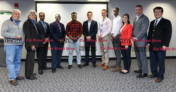 041317 Wesley Bunnell | Staff Students from CCSU gave business presentations during the Stanley Black and Decker Business Plan Competition at the ITBD on Thursday evening. Professor Greg Berry, left, Professor Drew Harris, Ebrahim Ali, Joshua Fritho, Elijah Amoah, Jared Lockart, Chris Messier, Breylin Jones, Darian Carter, Dean of the School of Business Ken Colwell & Professor Chris Lee.