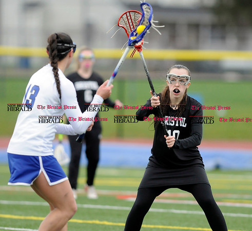 4/7/2016 Mike Orazzi | Staff Southington's Morgan Raymond (13) during Thursday's lacrosse with the Bristol co-op's Emily Stadnicki (10).