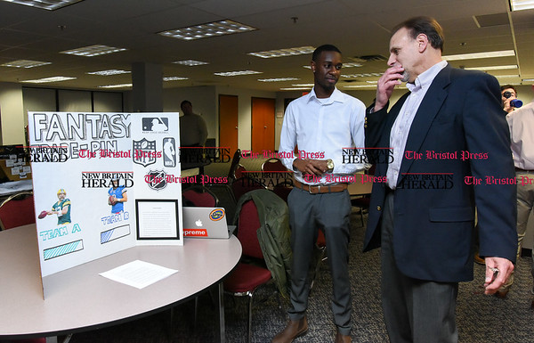 041317 Wesley Bunnell | Staff Students from CCSU gave business presentations during the Stanley Black and Decker Business Plan Competition at the ITBD on Thursday evening. Breylin Jones, middle, discusses his business plan pre competition.