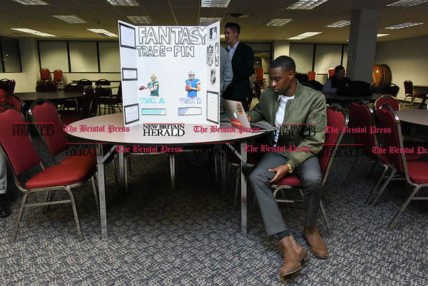 041317 Wesley Bunnell | Staff Students from CCSU gave business presentations during the Stanley Black and Decker Business Plan Competition at the ITBD on Thursday evening. Breylin Jones prepares for his presentation on Fantasy TradePin for fantasy sports before the competition.