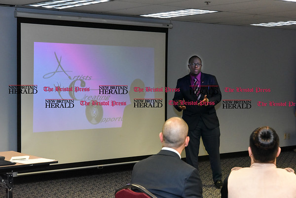 041317 Wesley Bunnell | Staff Students from CCSU gave business presentations during the Stanley Black and Decker Business Plan Competition at the ITBD on Thursday evening. Joshua Fritho presents his plan on Artist Creating Opportunities to the judges.