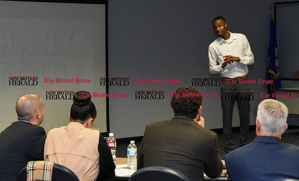 041317 Wesley Bunnell | Staff Students from CCSU gave business presentations during the Stanley Black and Decker Business Plan Competition at the ITBD on Thursday evening. Breylin Jones during his presentation on Fantasy TradePin.
