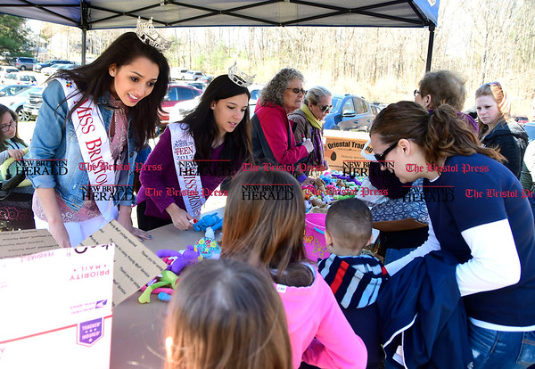 4/14/2017 Mike Orazzi | Staff Miss Bristol Gina Salvatore and Miss Teen Bristol Victoria Kilbourne pass out prizes during the Barnes Memorial Nature Center's Annual Easter Egg Hunt on Friday in Bristol.