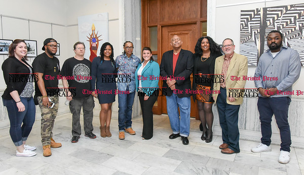 041217 Wesley Bunnell | Staff The New Britain Artists' Co-op held a reception at City Hall on Wednesday evening featuring work by co-op members. Arts Commissioner Felicia Leone, left, Maciah M Dot Clark, James Malloy, Kayla Farrell, Adrian Elliot, Mayor Erin Stewart, Charles Fort, Victoria Cloud, Executive Director of New Britain Arts Alliance Stephen Hard & open mic participant Antonio Kershaw.