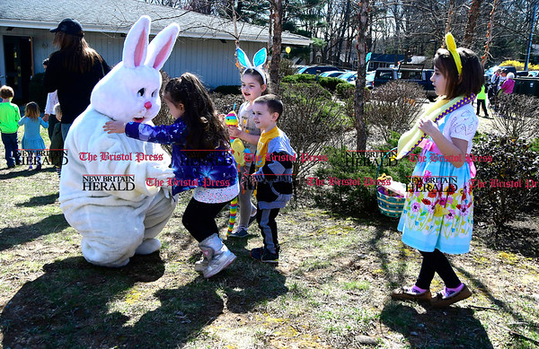 4/14/2017 Mike Orazzi | Staff The Easter bunny greets children during the Barnes Memorial Nature Center's Annual Easter Egg Hunt on Friday in Bristol.