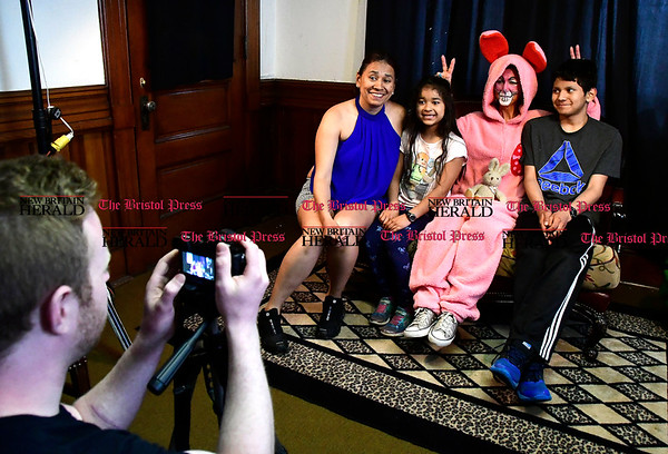 4/15/2017 Mike Orazzi   Staff Members of the Suarez family, l to r: Christina, Araceli and Vicente, pose with the Easter bunny, Annie Salgado during the Annual Easter Egg Hunt at Trinity-on Main Saturday in New Britain.