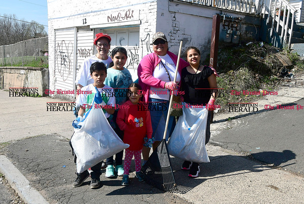4/15/2017 Mike Orazzi   Staff Volunteers while cleaning up on Oak Street during the The North Oak-Neighborhood Revitalization Zone community cleanup Saturday. In the background is Jon Zipadelli.