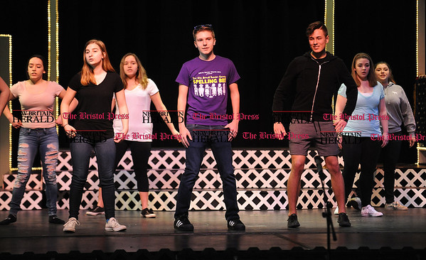 4/15/2017 Mike Orazzi | Staff OM Show cast members from the Teen Chorus during rehearsal at St. Paul Catholic High School on Saturday while preparing for next weekends' shows.
