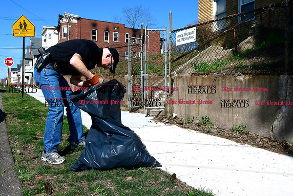 4/15/2017 Mike Orazzi | Staff New Britain Police Chief James Wardwell cleans up on West Street during the The North Oak-Neighborhood Revitalization Zone community cleanup Saturday.