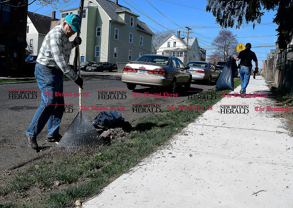 4/15/2017 Mike Orazzi | Staff New Britain Alderman Don Naples cleans up on West Street during the The North Oak-Neighborhood Revitalization Zone community cleanup Saturday.