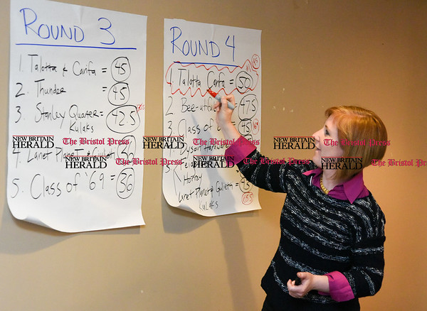 042017 Wesley Bunnell | Staff The New Britain Industrial Museum held their first annual trivia night fundraiser at the Elks Club on Thursday night. Kate Hayden circles the nights winner on the final round scoresheet.