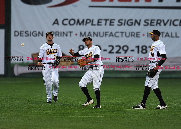 4/21/2017 Mike Orazzi | Staff New Britain Bees' Conor Bierfeldt (28), Steve Carrillo (4) and Mike Crouse (10) on opening night at New Britain Stadium Friday night.