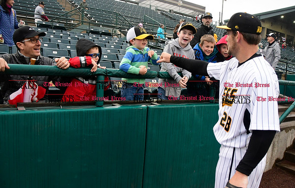 4/21/2017 Mike Orazzi | Staff New Britain Bees' Conor Bierfeldt (28) greets fans on opening night at New Britain Stadium Friday night.