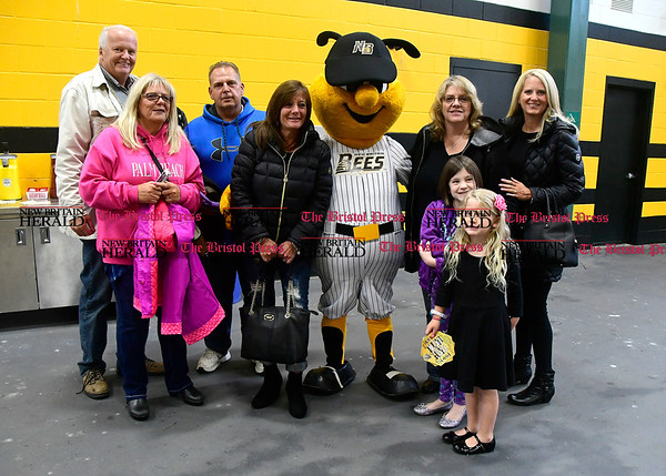 4/21/2017 Mike Orazzi | Staff New Britain Bees fans pose with the Bees' mascot on opening night at New Britain Stadium Friday night.