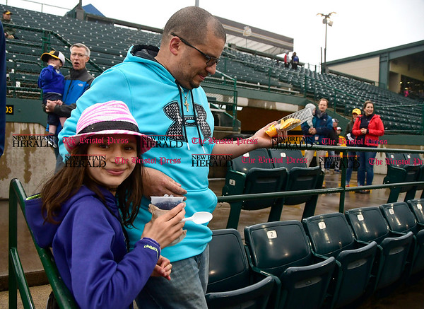 4/21/2017 Mike Orazzi | Staff Melvin and Brianna Tirado look for their seats on opening night at New Britain Stadium Friday night.