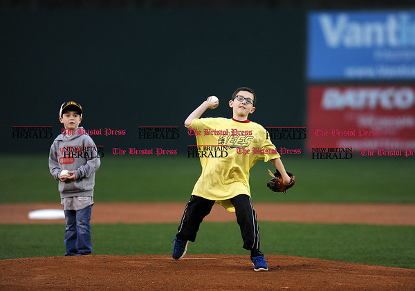 4/21/2017 Mike Orazzi | Staff William Giblin throws out one of the first pitches on opening night at New Britain Stadium Friday night.