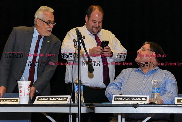 042517 Wesley Bunnell   Staff The New Britain Common Council held its annual public hearing at 7 p.m. Tuesday evening at Smalley Academy regarding Mayor Erin Stewart's proposed budget plan. After a quick meeting with little public participation Aldermen Daniel Salerno, Jamie Giantonio and Carlo Carlozzi Jr prepare to leave.