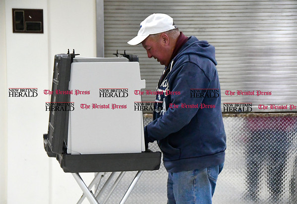 4/25/2016 Mike Orazzi | Staff Roland Legere casts his vote during the budget vote in Plainville on Tuesday.