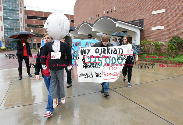 042517 Wesley Bunnell | Staff Facing budget cuts from the State of CT students and faculty organized a protest against CSCU's President Mark Ojakian's budget proposal which they fear would weaken the CCSU campus. Protestors march from Welte Hall to the CCSU Student Center.