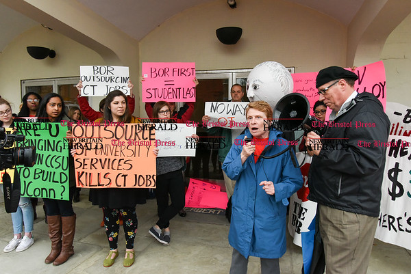 042517 Wesley Bunnell | Staff Facing budget cuts from the State of CT students and faculty organized a protest against CSCU's President Mark Ojakian's budget proposal which they fear would weaken the CCSU campus. CCSU History Professor Kathy Hermes speaks to the crowd.