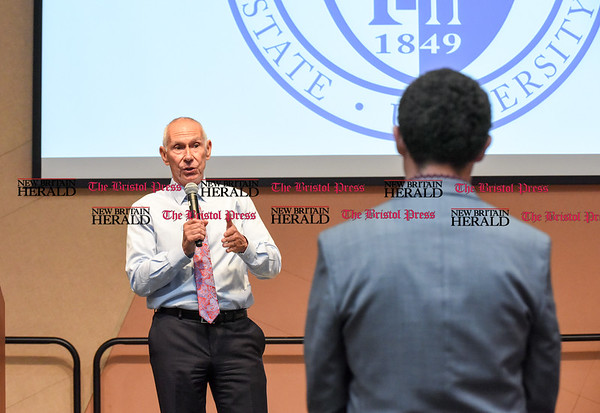 042517 Wesley Bunnell | Staff Facing budget cuts from the State of CT students and faculty organized a protest against CSCU's President Mark Ojakian's budget proposal which they fear would weaken the CCSU campus. Mark Ojakian stands on stage answering a question from an audience member.